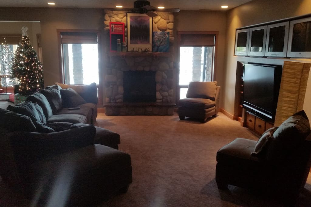 "Living Area. Fire Place. 65"" TV"
