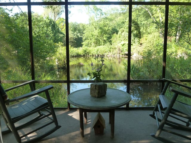 Antique rockers are the perfect place to watch for the Blue Heron's that frequent our front pond.