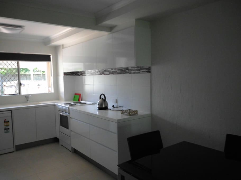A modern newly renovated kitchen with self closing drawers.