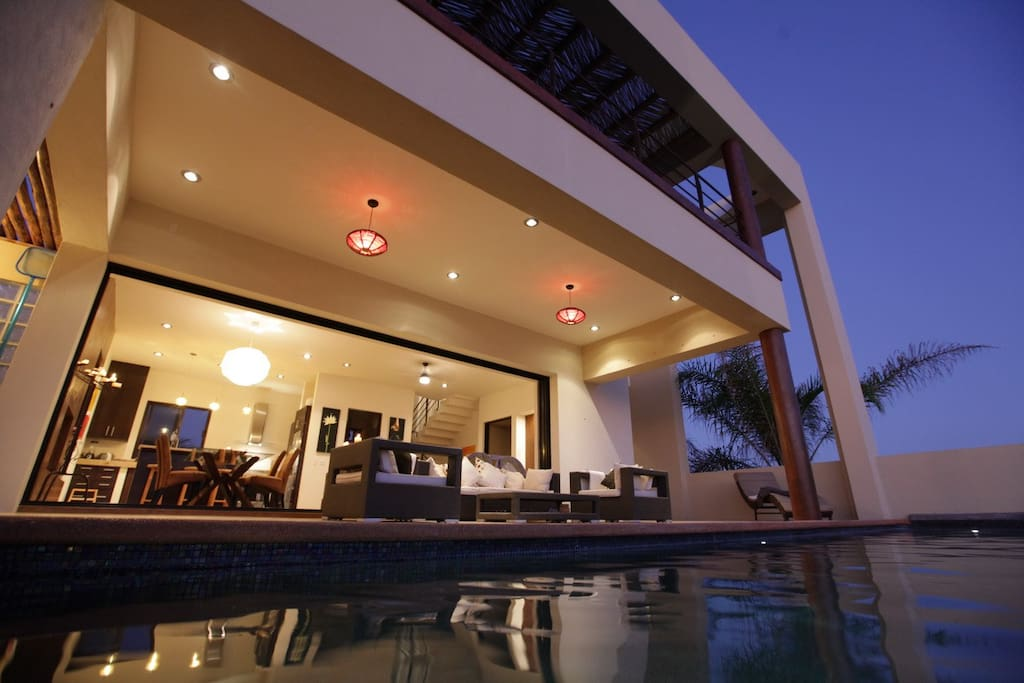 View of pool deck at twilight