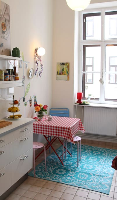 Our fully equipped clean white kitchen with the kitsch corner.