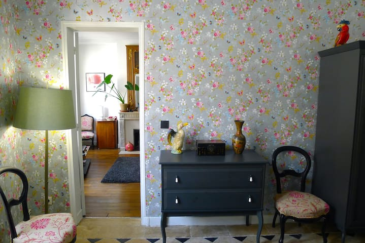 Bedroom. Love our kitsch wallpaper. And the parrot.