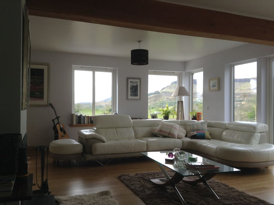 Feel free to relax in the comfortable, modern living room and enjoy the views.
