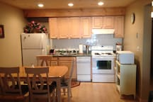kitchen with dishwasher, coffee maker and microwave