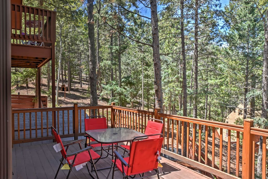Enjoy the private setting of this property along with picturesque views from this wrap-around deck.