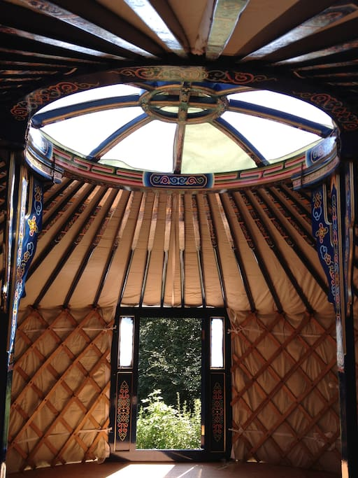Hand painted by the Mongolians who made the yurt. The yurt overlooks the slope down through the trees to the lake.