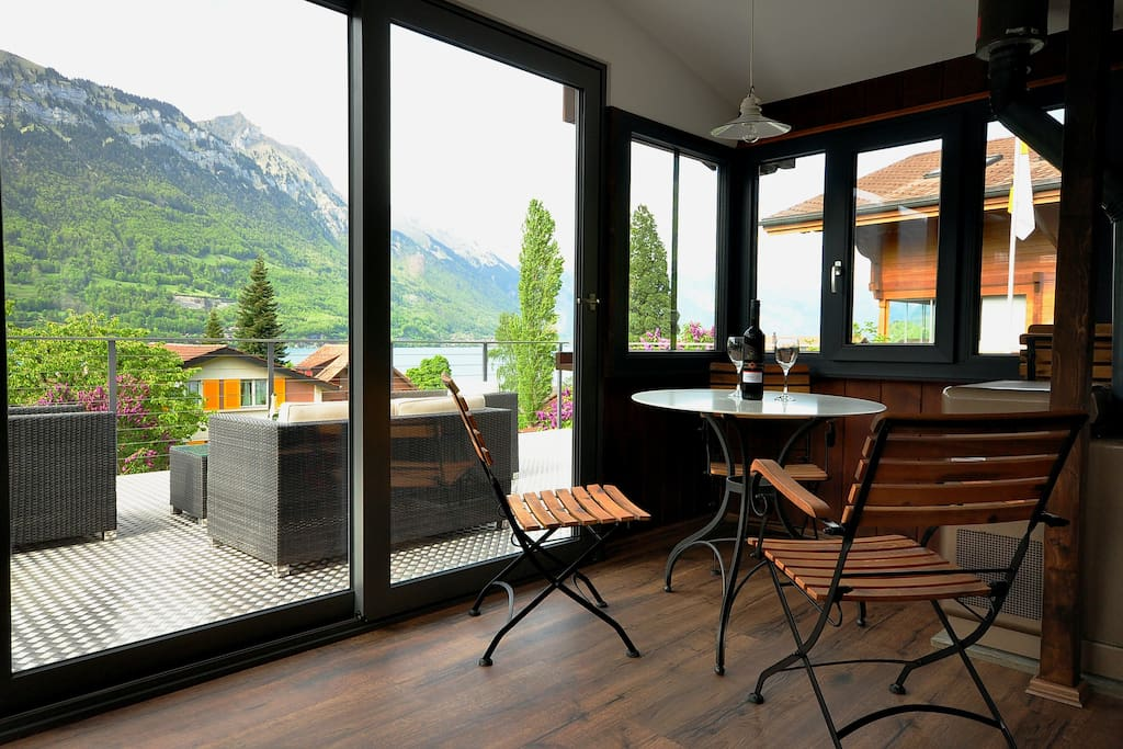 Inside dining for four with amazing view of Lake Brienz.