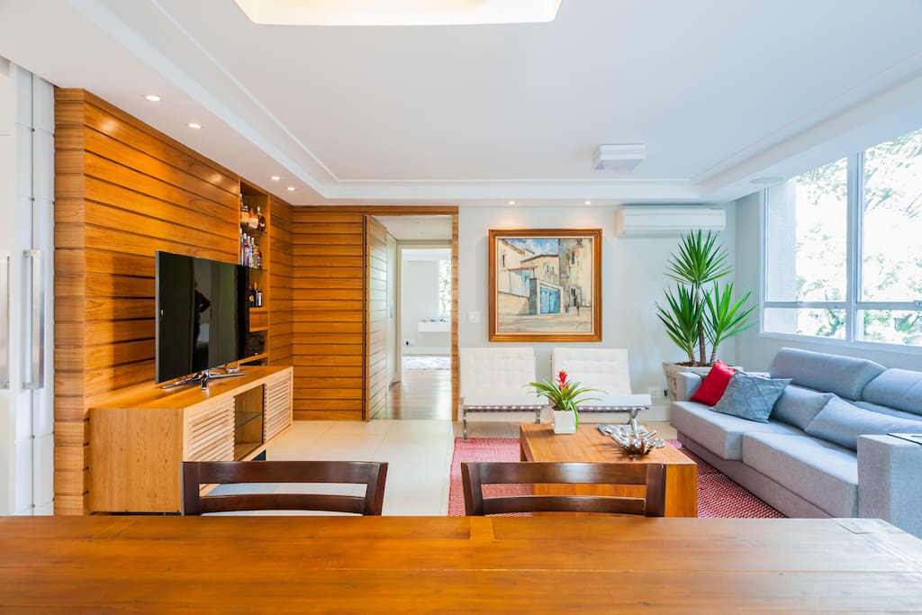 Modern, clean, nice decoration, wood feeling,  surrounded by a green view and natural lights.