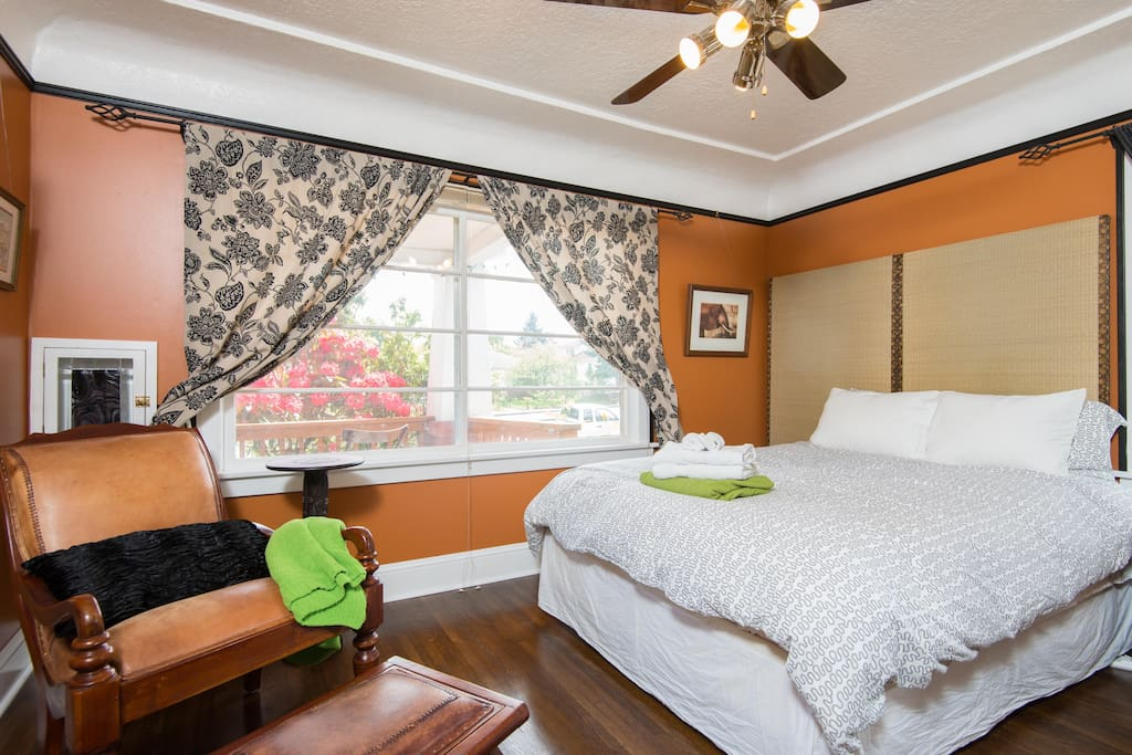 Comfortable queen bed with down comforters and pillows