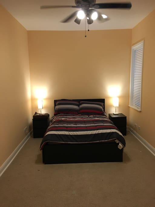 Main Master Bedroom - full size platform bed with built in drawers, walk-in closet in room, bedside tables lamps and remote controlled ceiling fan. Additional space available in basement for storage.
