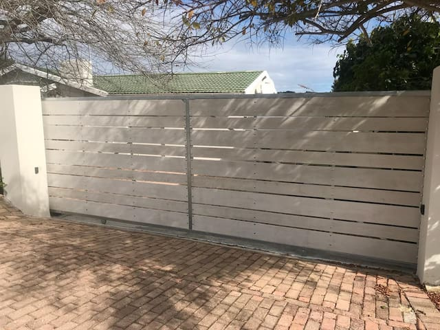 Secure property with electric gate