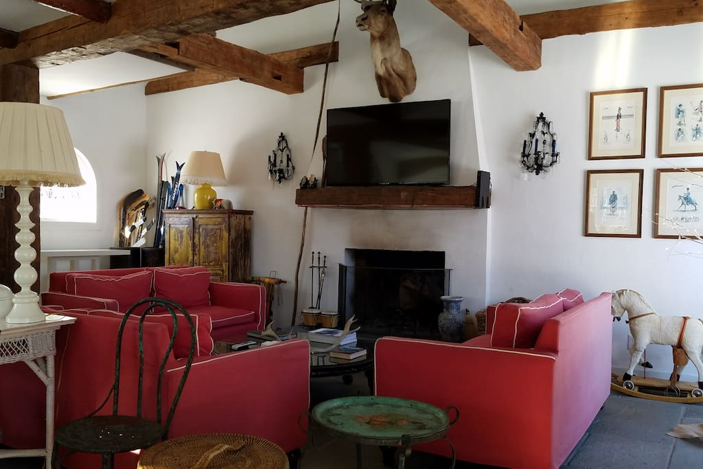 Guest House Family Room with slate floor and hand hewn beams