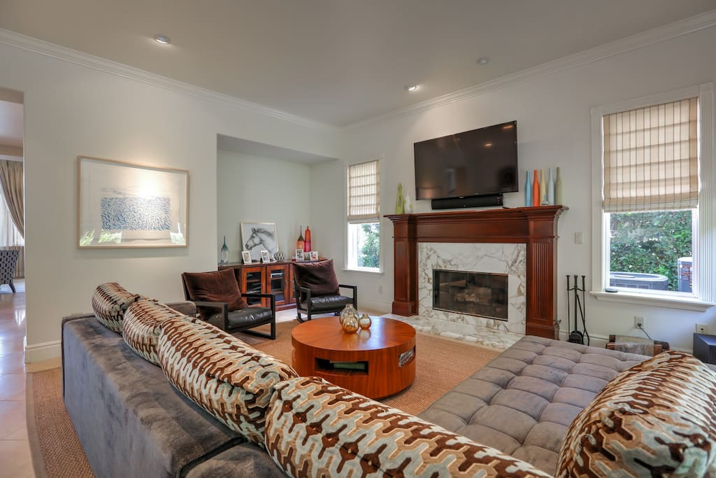 The Family Room also features a gas fireplace and large TV