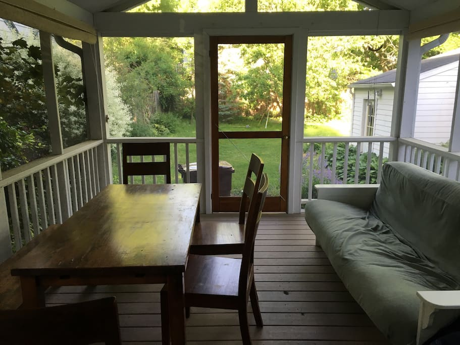 Fully screened-in back porch.
