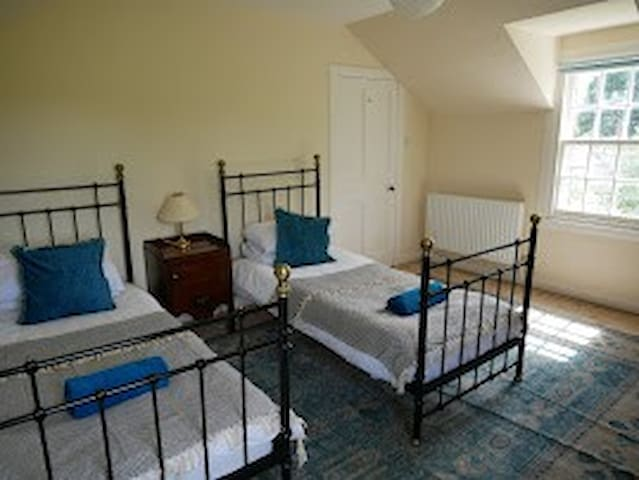 The twin room, upstairs looks south and west with great view of the farmland and sheep.