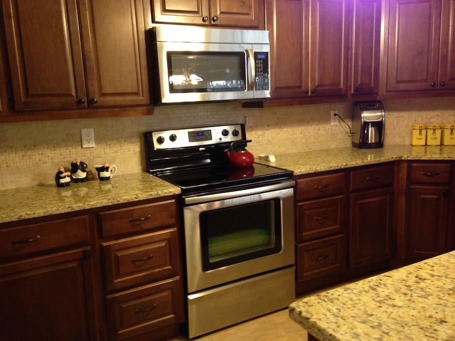 Newly remodeled kitchen with granite, stainless steel and complete meal prep accessories.