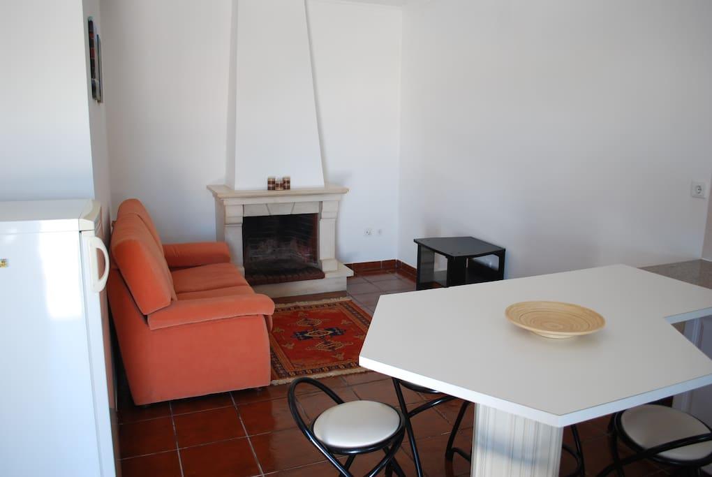 Interior, com sala e Cozinha