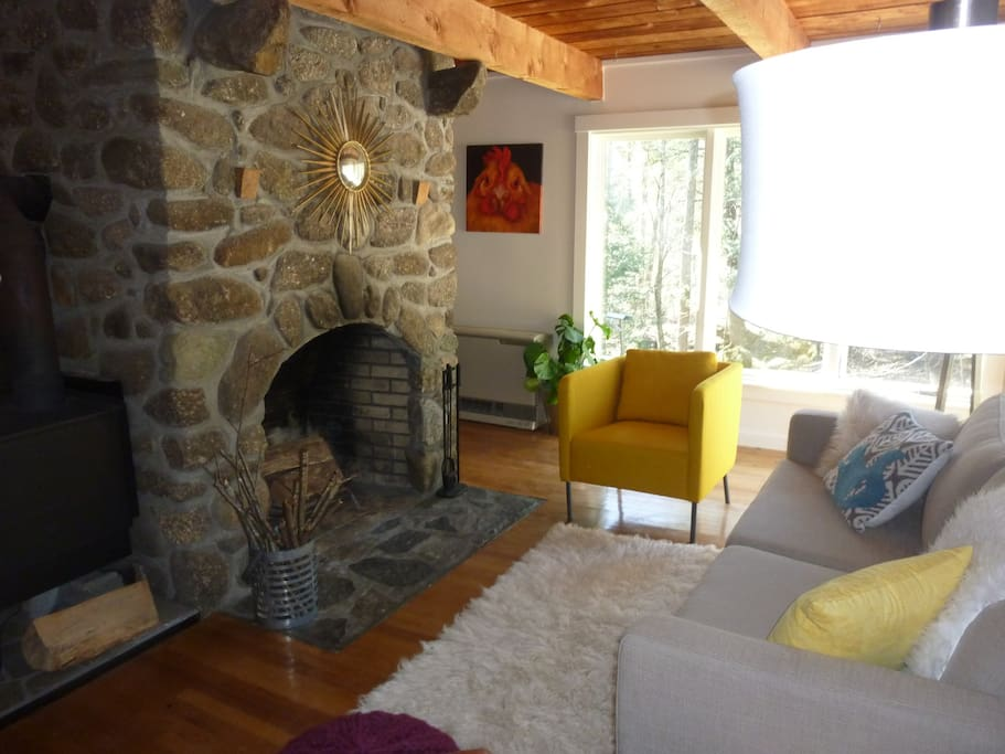 The main living room with a beautiful stone fireplace.