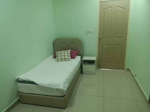A standard  size bedroom with inbuilt  cupboards and a private bathroom across the hall.  For comfort, windows, a ceiling fan and aircon.  Access to kitchen  washing machine and whole living area.