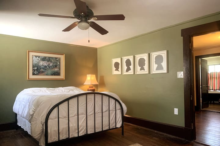Large Bedroom 3 with a queen bed and sofa.  Hall bathrooms are just outside the door.