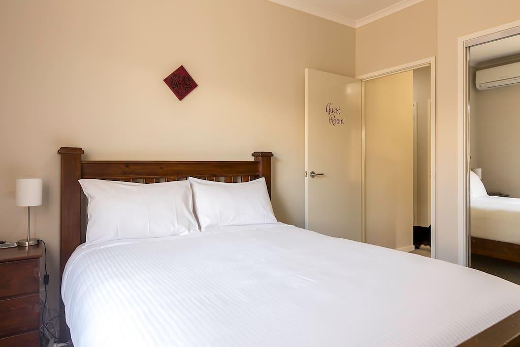 Very comfortable queen bed with deluxe sheets. Bedroom 1