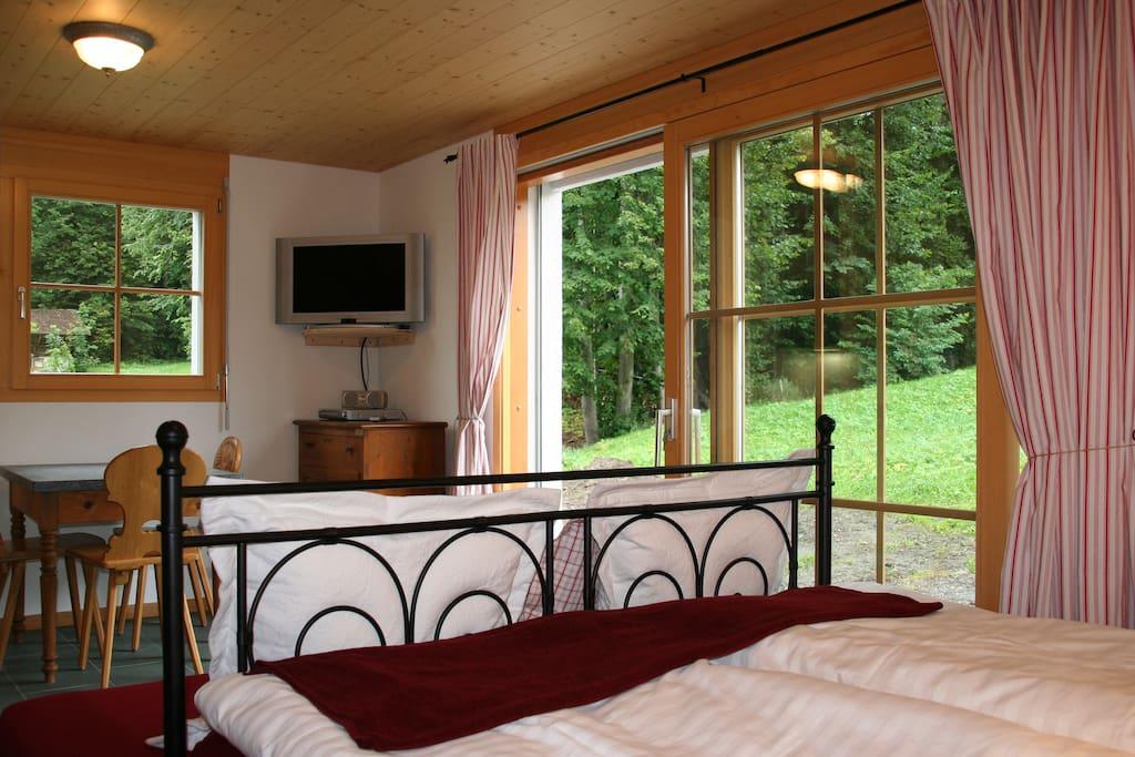 Livng area w/bed. Natural slate floors