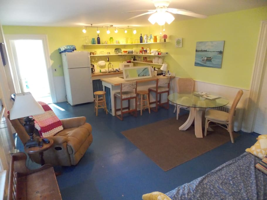 Shared kitchen,  living space, and shared bathroom.