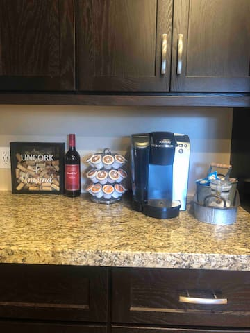 Enjoy a complementary bottle of local wine, coffee and creamer.