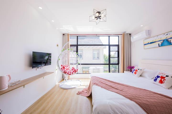 【留时光】免费接送乐园含早餐+超大床落地大窗都市房带摇篮椅