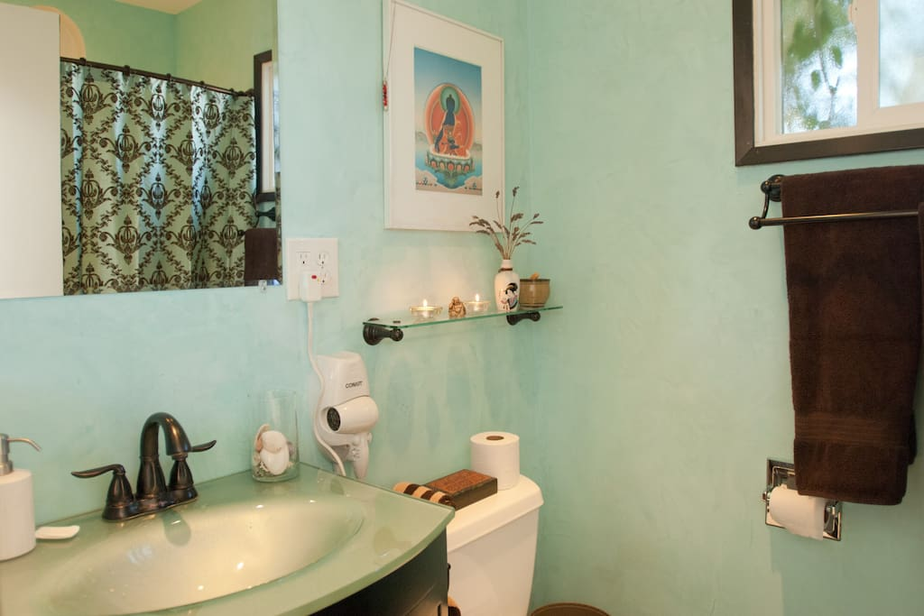 Squeaky clean bathroom with a great ceiling fan/heater and a big tub to soak in if you wish.