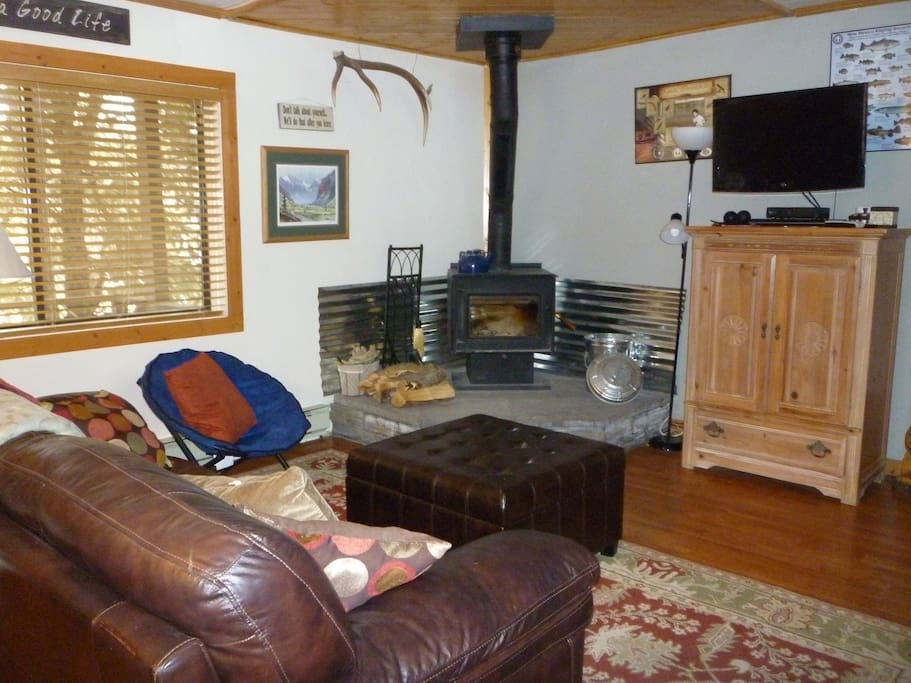 enjoy the cozy living area with wood burning stove