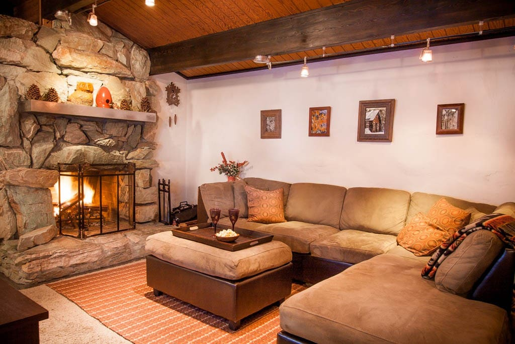 stone fireplace and comfy L-shaped couch