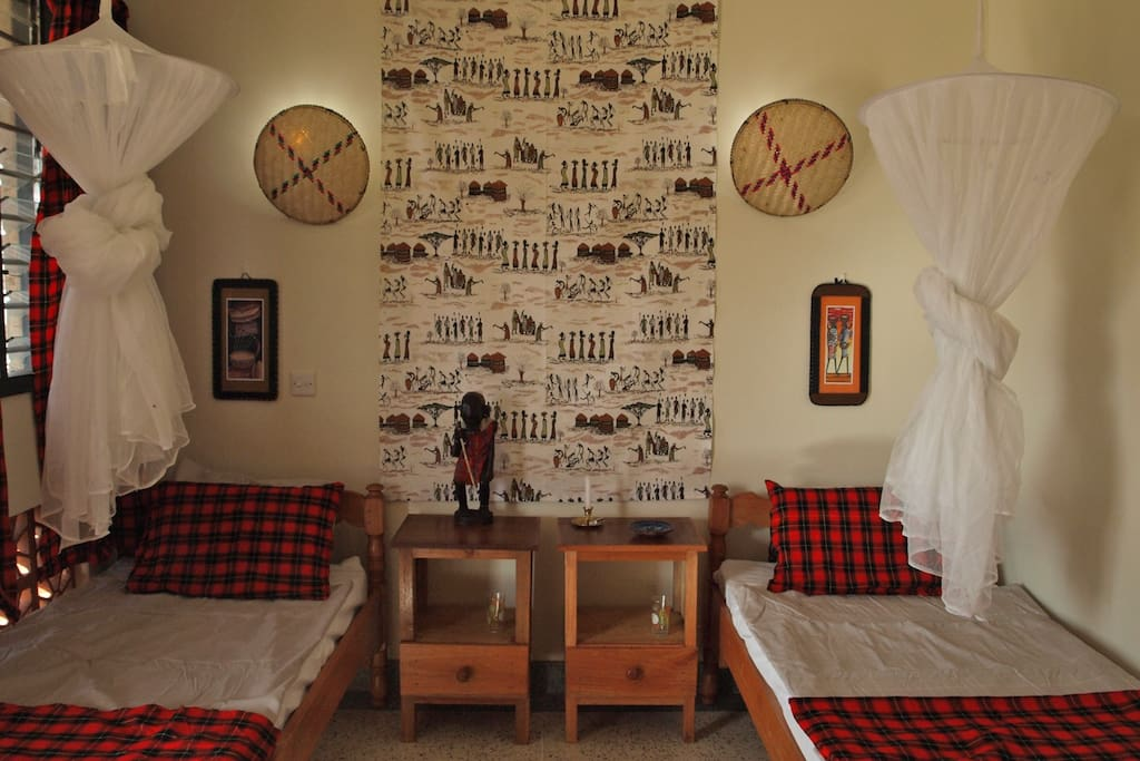 One of the double rooms is decorated in classic Maasai style.