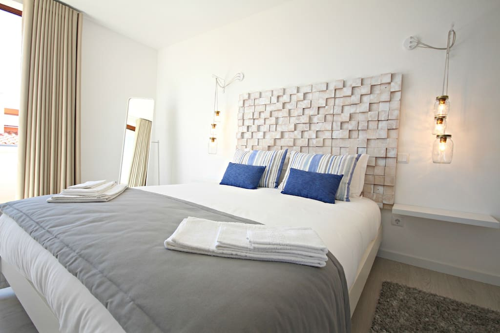 Main bedroom with double bed and luxury ensuite bathroom