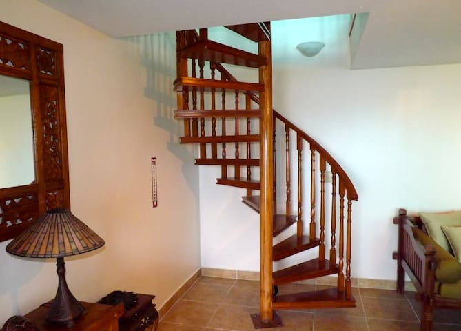 Spiral staircase leading to upstairs bedroom  and kitchen/bath area.  Leave your luggage downstairs and just bring what you need upstairs.