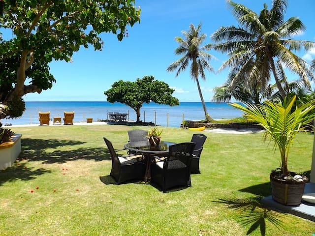 Landscaped backyard overlooking the ocean