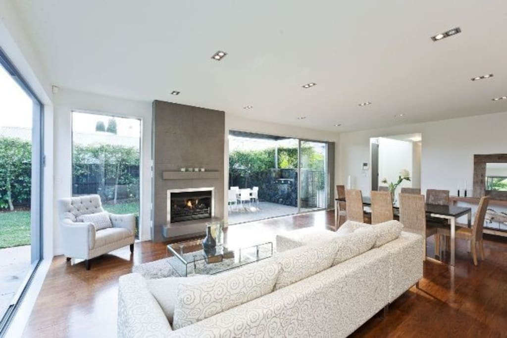 Family room with gas fireplace. Electric external louvres and gas fire place.