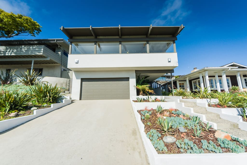 Home is perched on the hill overlooking the ocean and just 300' from the sand.
