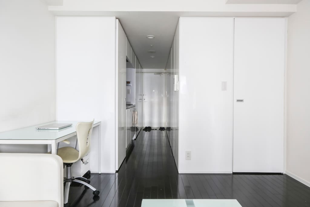 Hallway opens up into large living space.