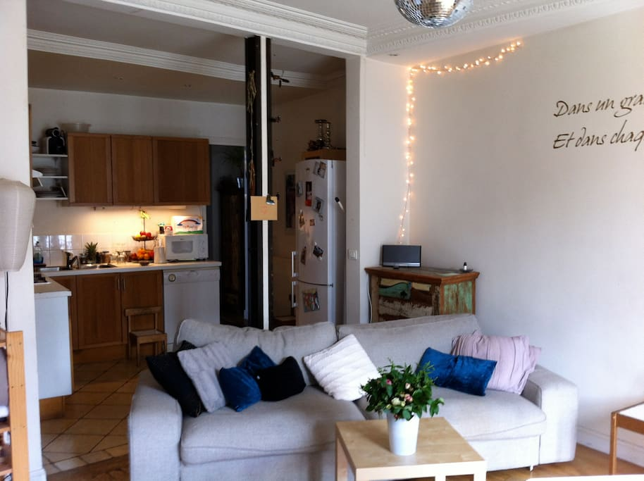 A sunny living room, with sofa Bed for Two