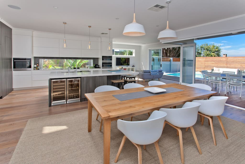 Entertainers kitchen, with built in fridges, pantry, wine and drinks fridges, steam oven, 2 other ovens. 8 seat dining area leading straight onto the deck