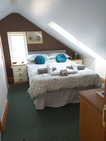 Bedroom  1. This has a toilet and wash basin. Wardrobe and dressing table. Dressing gown's and slippers are provided. Also hairdryer supplied.
