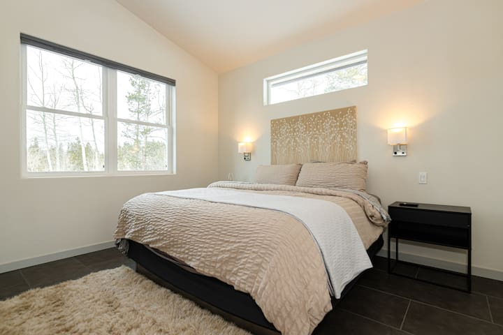 """King Bedroom 2 of 3 on main level. This bedroom also has a 48"""" Smart TV and Private bath attached"""