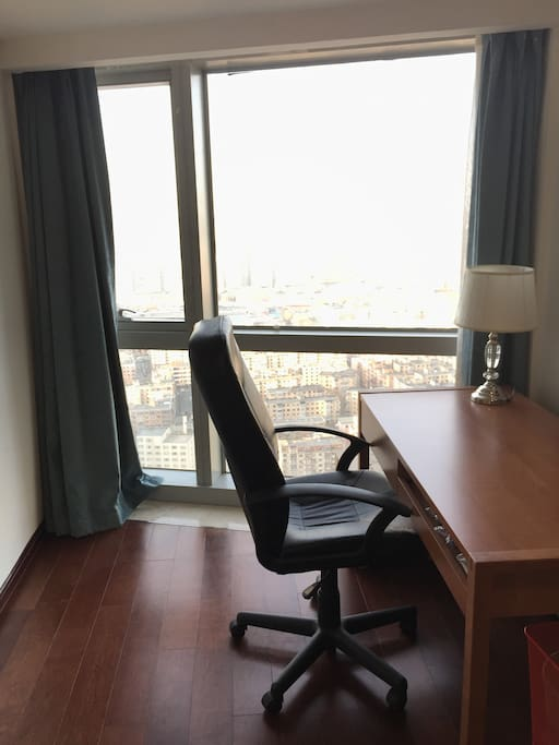 Bedroom has a desk for work