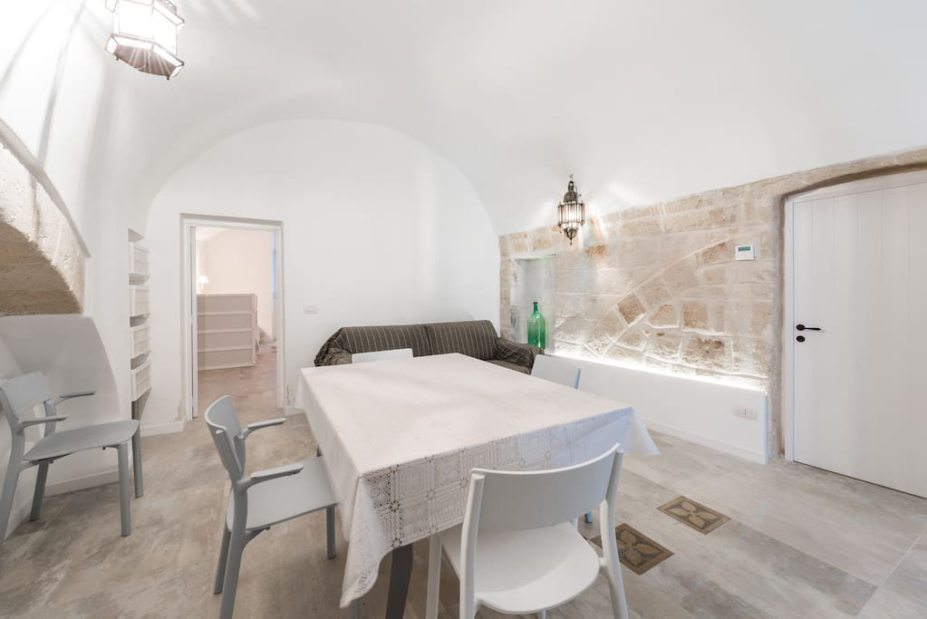Dining - the table is light to move around and foldable to stay within the arch niche