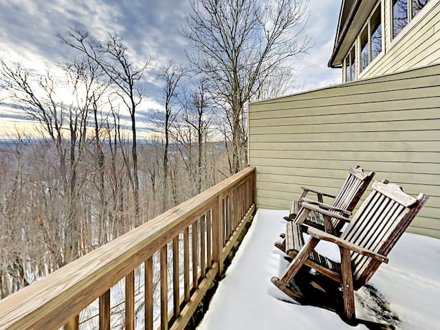 Head to the private back deck to enjoy spectacular mountain views.