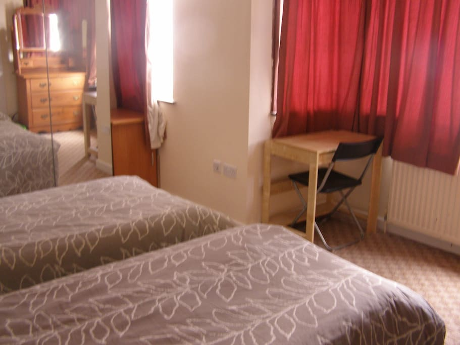 The 2 single beds, mirrored wardrobe and another desk and chair!