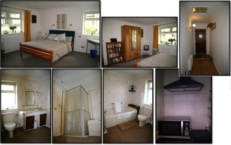 Double aspect large bedroom with antique wardrobe. Spacious for solo guests.