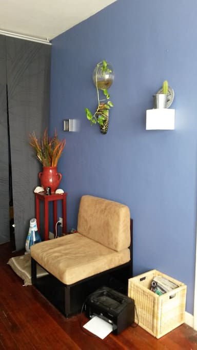 Living room with seating and wall plants