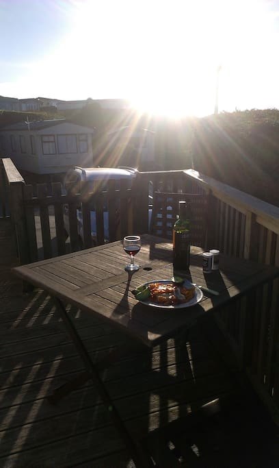 Dinner on the deck. There are 2 garden tables on the deck- this one looking west and the other one faces east and ovelooks the nature reserve and the ISle of Wight